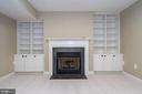 Gas fireplace with built in shelving surround - 26112 TALAMORE DR, CHANTILLY