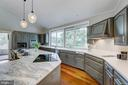Kitchen island with induction cooktop - 98 POINT SOMERSET LN, SEVERNA PARK