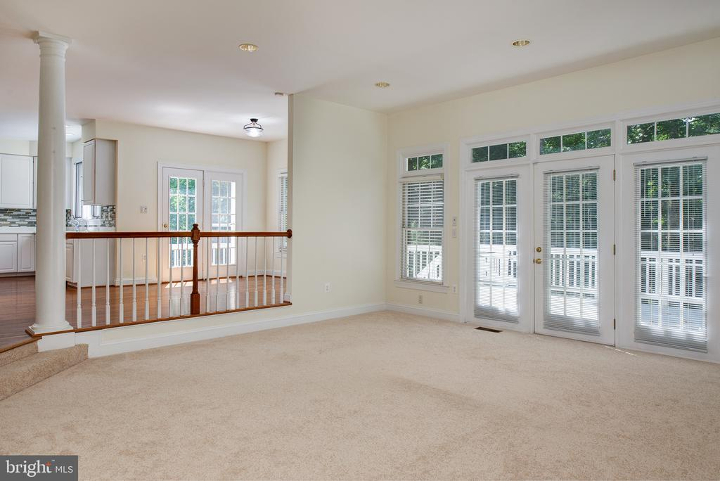 Family Room is next to the Breakfast Room - 1144 ROUND PEBBLE LN, RESTON