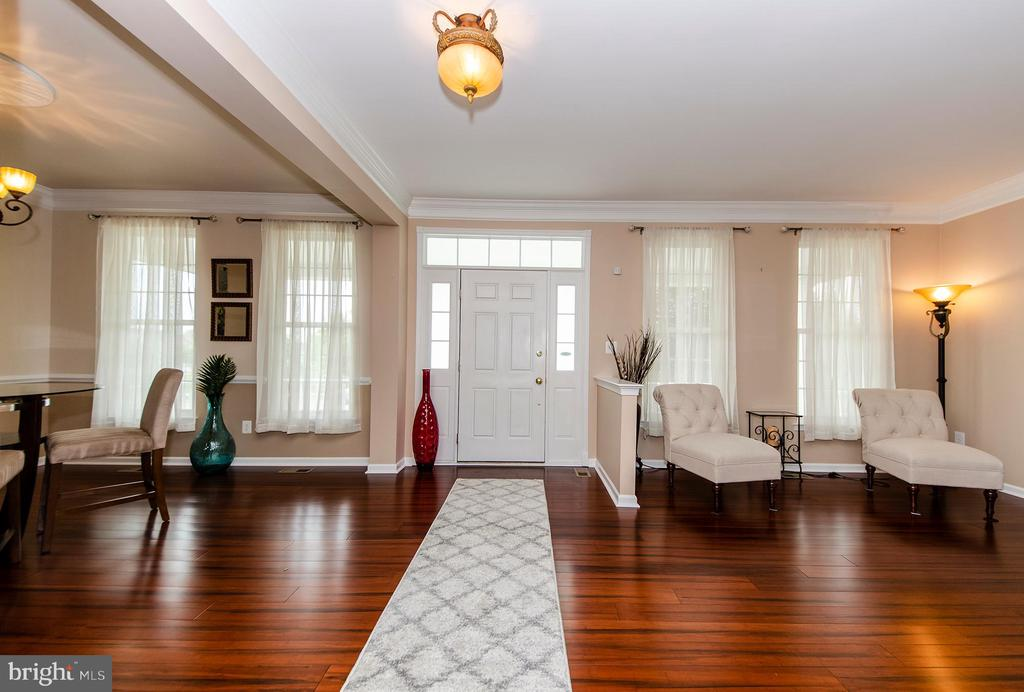 Gorgeous hardwood floors throughout main level - 25233 RIDING CENTER DR, CHANTILLY