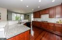 Upgraded kitchen with beautiful wood cabinets - 25233 RIDING CENTER DR, CHANTILLY