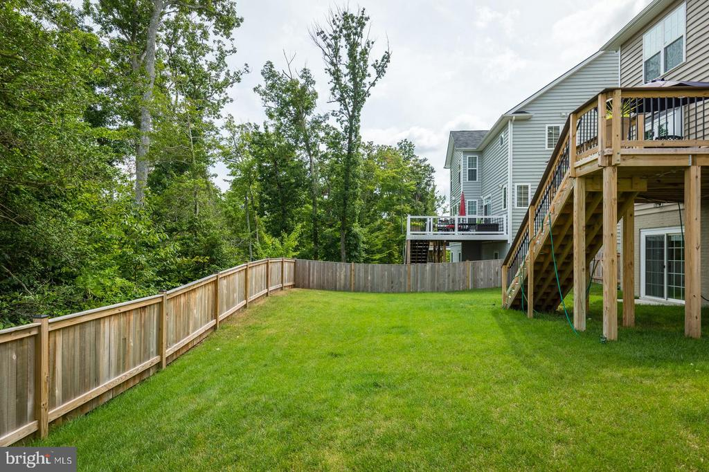 View along the back fence line. - 9 WOODLOT CT, STAFFORD