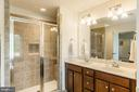 Master bathroom w/ dual vanity & title shower. - 9 WOODLOT CT, STAFFORD