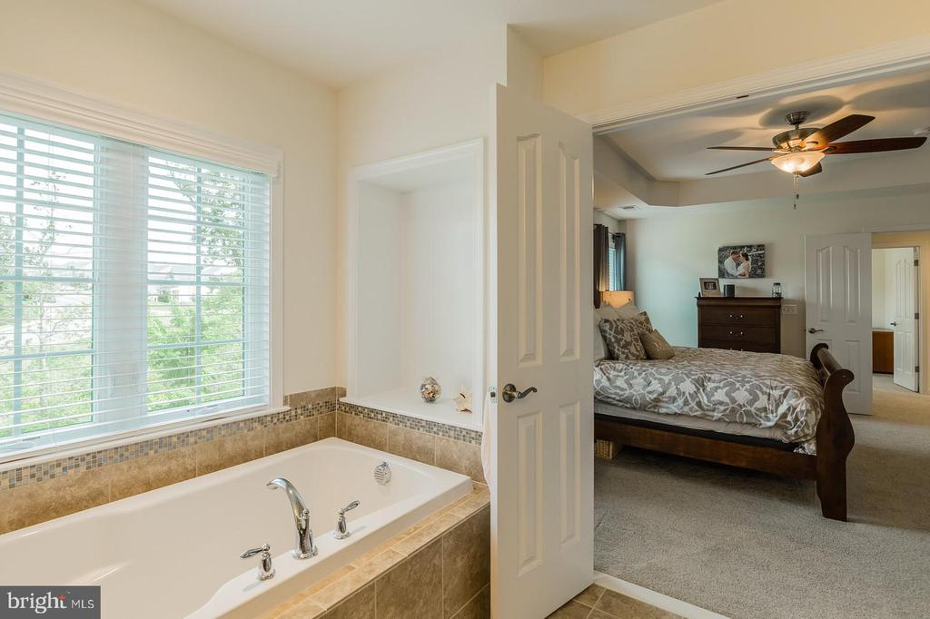 The transition from master bathroom to bedroom. - 9 WOODLOT CT, STAFFORD