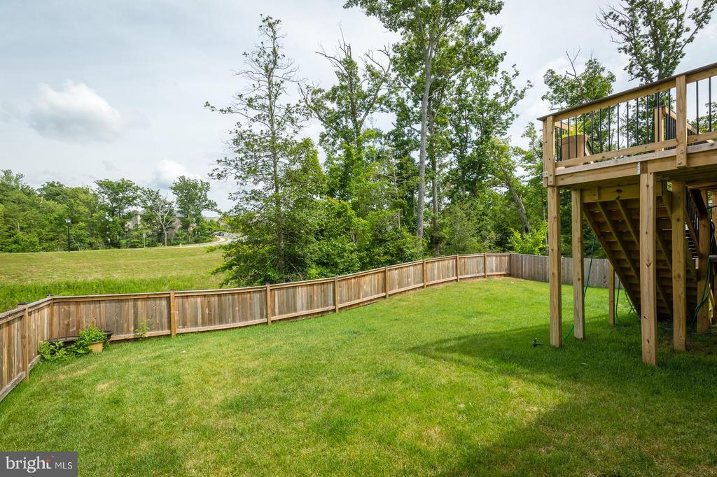 Completely fence backyard.  $2,800 upgrade. - 9 WOODLOT CT, STAFFORD