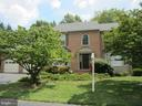 Front of home has mature trees - 12001 SUGARLAND VALLEY DR, HERNDON