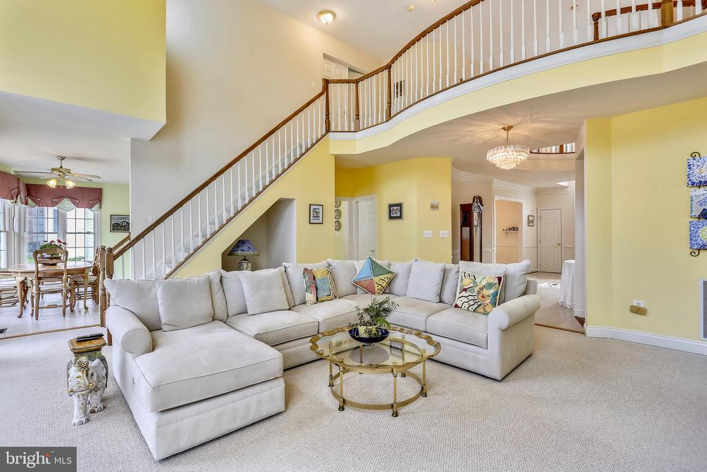 2 story Family room with second staircase and FP - 16813 HARBOUR TOWN DR, SILVER SPRING