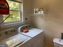 Laundry room with water view - 17972 SWANS CREEK LN, DUMFRIES