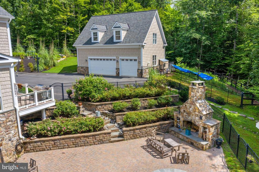 rear terrace, patio and stone fireplace - 11606 LAWTER LN, CLIFTON