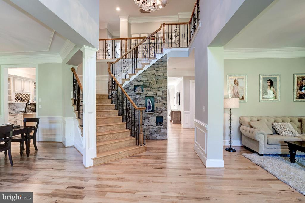 Entryway with dramatic staircase and stone wall - 11606 LAWTER LN, CLIFTON