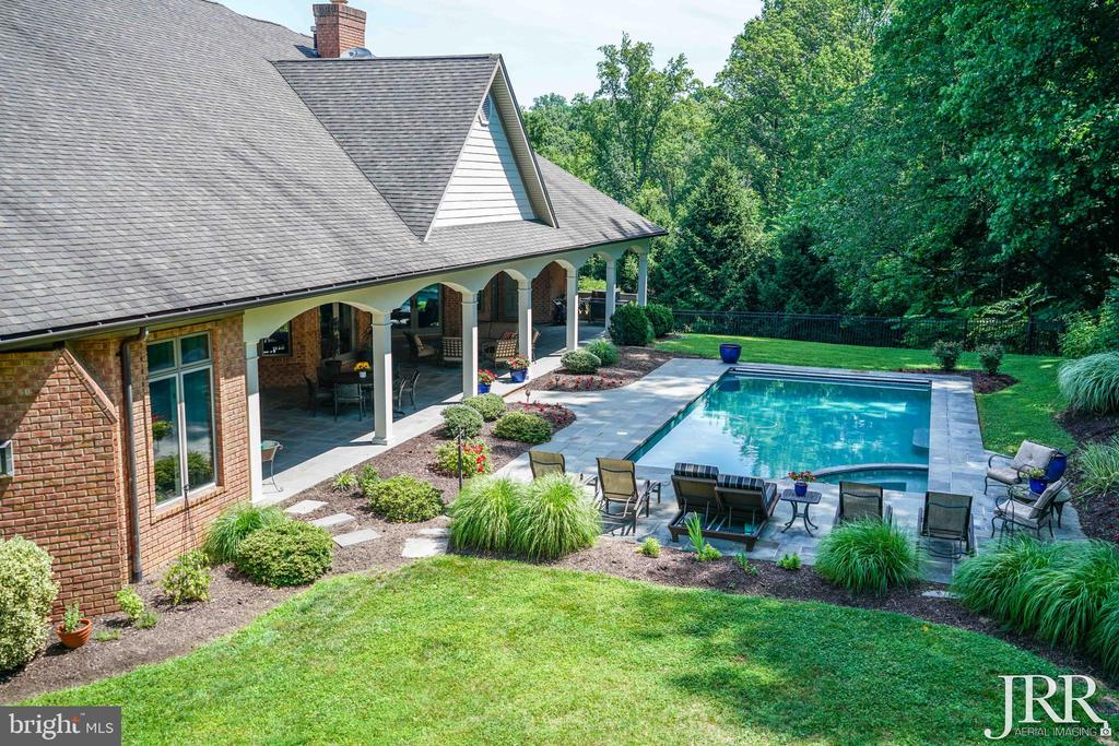 Stunning Views of the Landscaping around the Pool - 8544 LEISURE HILL DR, BALTIMORE