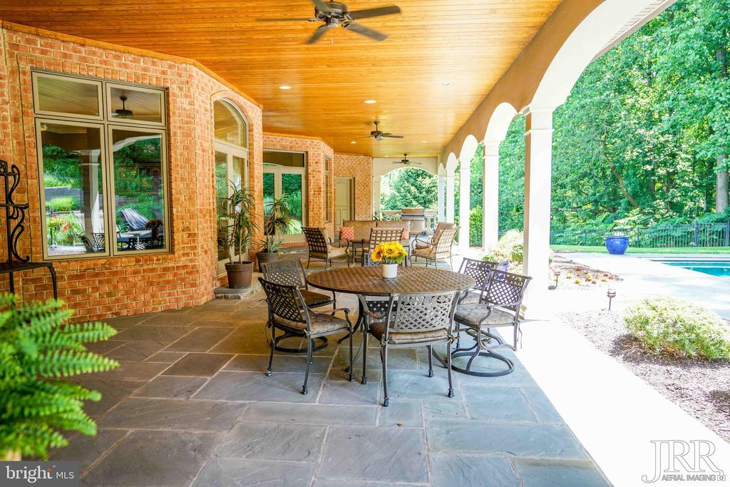 Lanai with Fireplace and Grill Area - 8544 LEISURE HILL DR, BALTIMORE