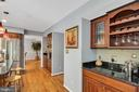 to the butler's pantry with wine storage - 4705 LEEHIGH CT, FAIRFAX