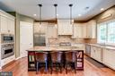 Large island with seating - 3001 WEBER PL, OAKTON