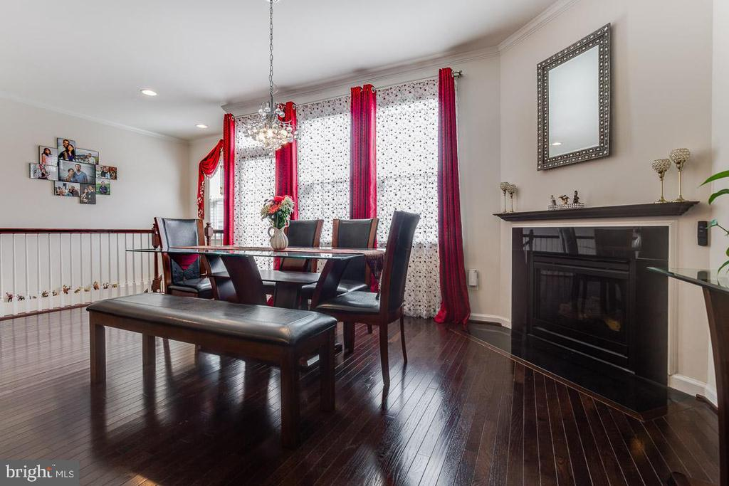 Dinning room with fireplace. - 24684 CAPECASTLE TER, ALDIE