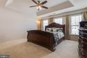 Master bedroom with tray ceiling. - 24684 CAPECASTLE TER, ALDIE