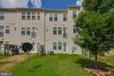 Rear of town home. - 24684 CAPECASTLE TER, ALDIE