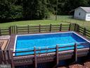 Above ground pool with deck and railing. - 195 BEREA CHURCH RD, FREDERICKSBURG