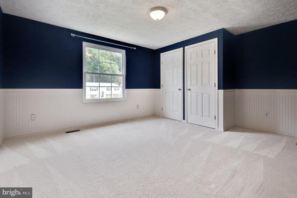 Bedroom 2 with charming wainscoting - 8419 RAINBOW BRIDGE LN, SPRINGFIELD