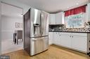 Lovely white cabinets and gleaming granite - 8419 RAINBOW BRIDGE LN, SPRINGFIELD