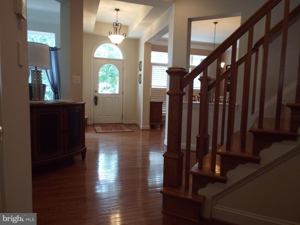 Open  Atrium and  stairs to second floor. - 22791 VICKERY PARK DR, BRAMBLETON
