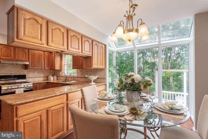 Kitchen and eat-in table space - 30 BRIDGEPORT CIR, STAFFORD