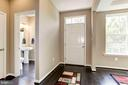 FOYER LEADING IN TO HALF BATHROOM ON MAIN LEVEL - 8717 LIBEAU DR, MANASSAS