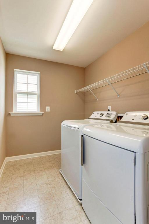 LAUNDRY ROOM - LARGE & LOCATED ON UPSTAIRS LEVEL - 8717 LIBEAU DR, MANASSAS