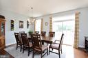 Dining area-Curtains rug convey - 16651 DANRIDGE MANOR DR, WOODBRIDGE