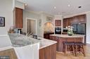 Kitchen flows into laundry room & garage - 12208 FAIRFAX STATION RD, FAIRFAX STATION