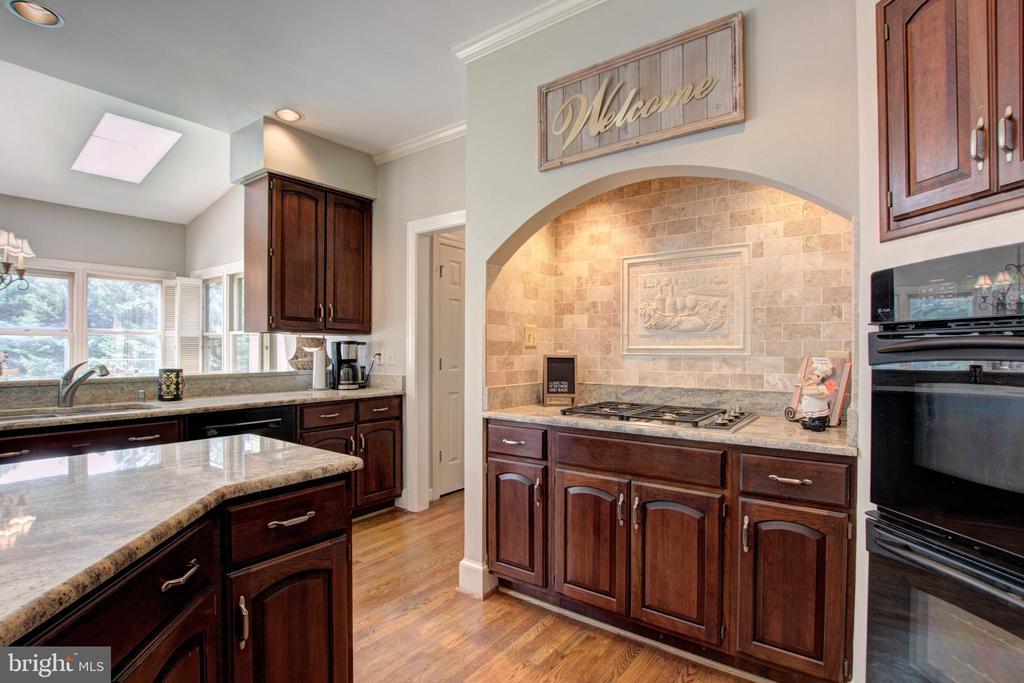 Kitchen shows off beautiful granite countertops - 12208 FAIRFAX STATION RD, FAIRFAX STATION