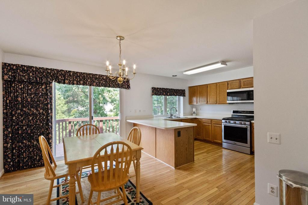 Large dining area with refinished hardwood floors - 7817 REBEL WALK DR, MANASSAS