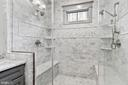 Dual benches in marble tiled shower - 2408 16TH ST N, ARLINGTON