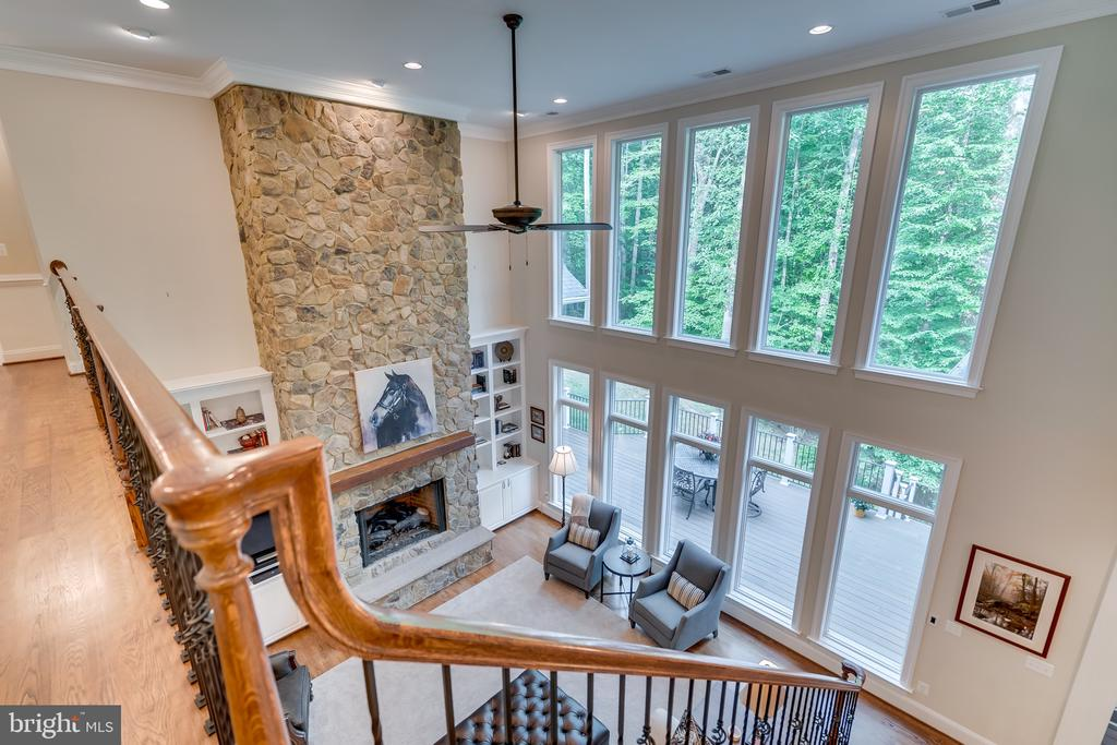 View of Family room from upstairs bridge - 8305 CRESTRIDGE RD, FAIRFAX STATION