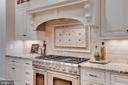 Gas cooktop, home has three ovens - 8305 CRESTRIDGE RD, FAIRFAX STATION