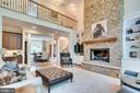 Family room with stone fireplace - 8305 CRESTRIDGE RD, FAIRFAX STATION