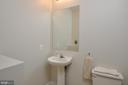 HALF BATHROOM ON MAIN LEVEL OFF KITCHEN - 48 BROOKE CREST LN, STAFFORD
