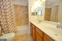 Second bath with dual sinks and ceramic tile - 19342 GARDNER VIEW SQ, LEESBURG