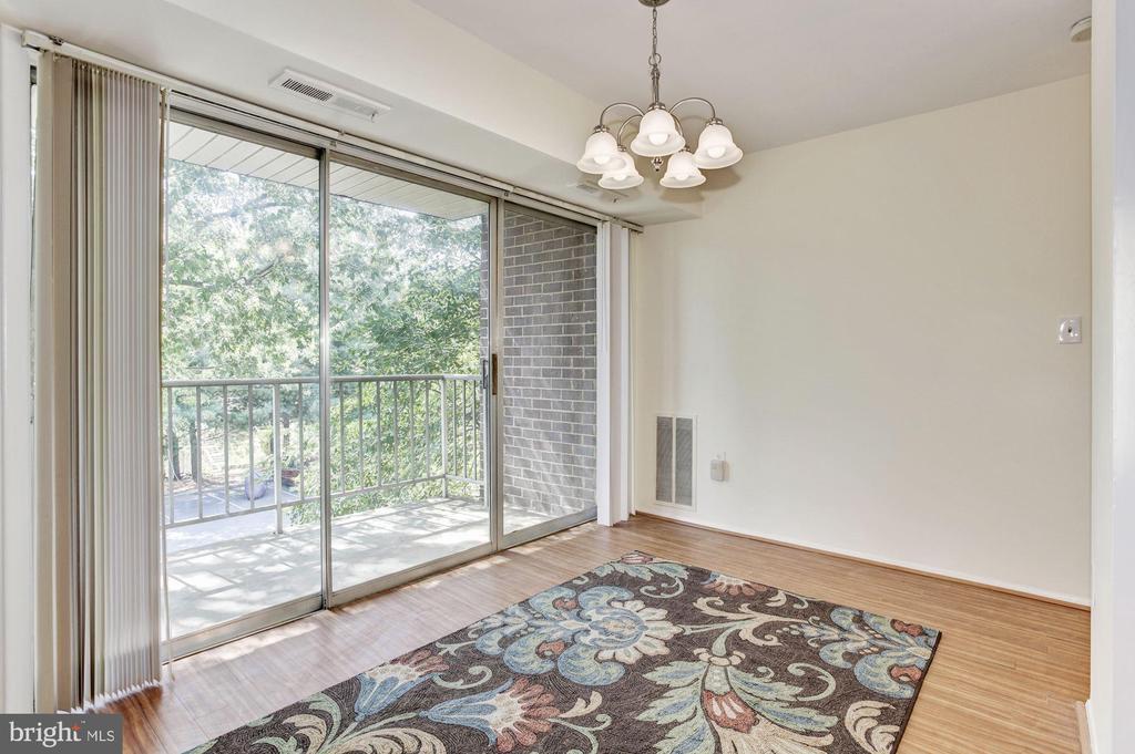 Dining room with patio door to balcony - 1600 RENATE DR #301, WOODBRIDGE