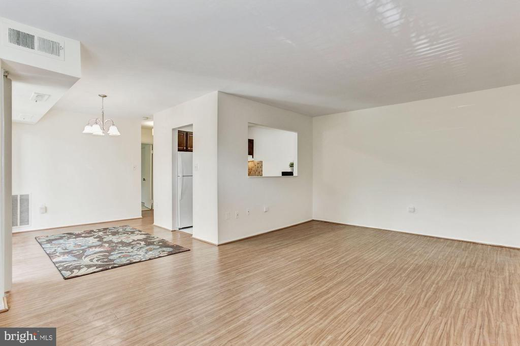 Living room opens to dining room - 1600 RENATE DR #301, WOODBRIDGE