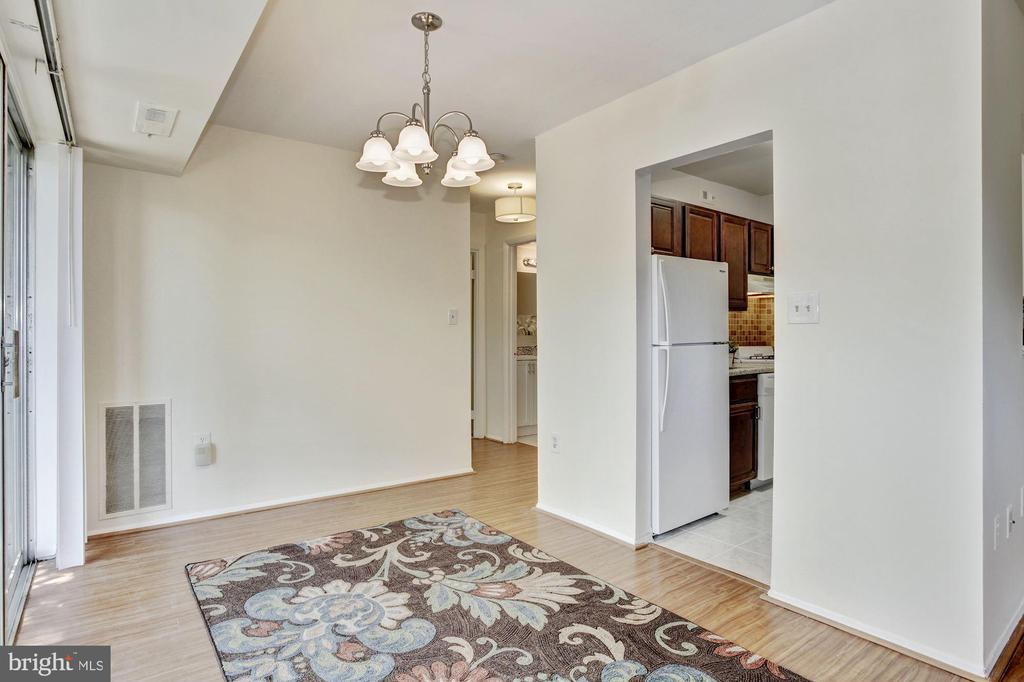Dining room with updated light fixture - 1600 RENATE DR #301, WOODBRIDGE