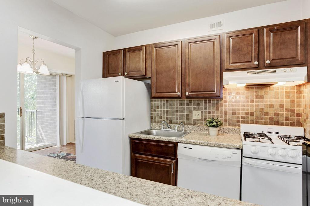 Kitchen with new frig & tile floor - 1600 RENATE DR #301, WOODBRIDGE