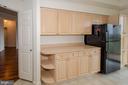 Kitchen and door to hallway and foyer - 19355 CYPRESS RIDGE TER #823, LEESBURG