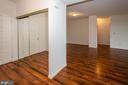 Foyer and mirrored doors to coat closet - 19355 CYPRESS RIDGE TER #823, LEESBURG