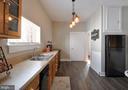 Kitchen view has second prep sink and utility room - 611 CAROLINE ST, FREDERICKSBURG