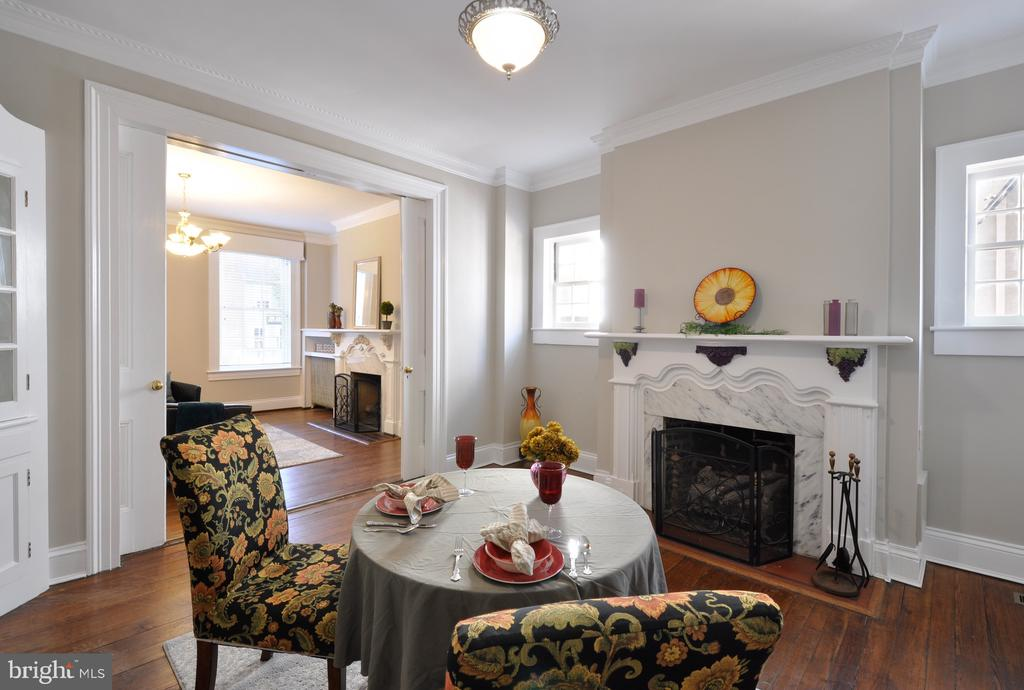 Dining room fire place with beautiful trim work - 611 CAROLINE ST, FREDERICKSBURG