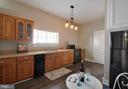 Kitchen, new stove/oven and new refrigerator - 611 CAROLINE ST, FREDERICKSBURG