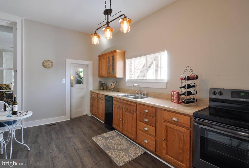 New light fixture and flooring in the kitchen - 611 CAROLINE ST, FREDERICKSBURG