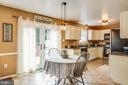 Eat-in kitchen with doors leading to the back deck - 5 ANTIETAM LOOP, STAFFORD