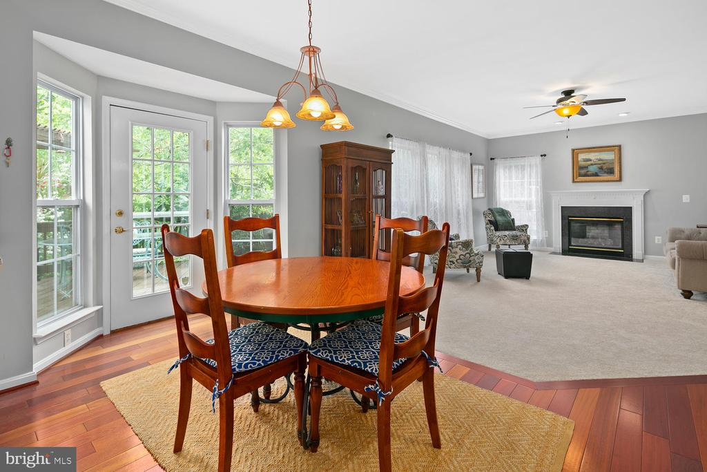 Kitchen table through to Family Foom - 21332 MARSH CREEK DR, BROADLANDS